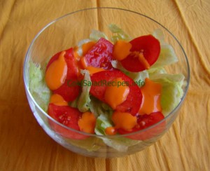 French dressing on tomato and lettuce cold salad